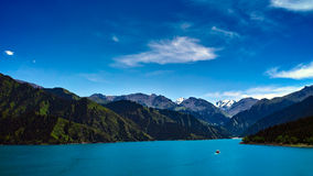 Lake and mountain. Green mountain with blue lake an sky Stock Image