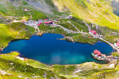Lake and mountain (Balea Lake in Romania). Landscape from Balea Lake in Romania and Fagaras mountains in the summer Royalty Free Stock Photos