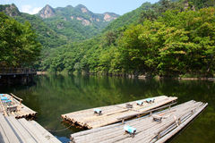 Lake, Mountain and Bamboo raft Royalty Free Stock Images