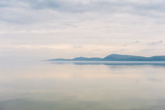 The lake and the mountain in the clouds in vermont Royalty Free Stock Photo