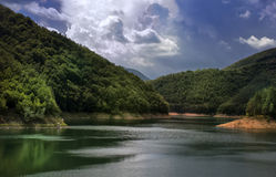 Lake in the mountain. With dramatic sky Stock Image