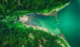 Lake in the mountain forest, aerial top view Royalty Free Stock Image
