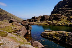 Lake on mountain ireland. Climbing mount brandon in ireland lake Royalty Free Stock Images