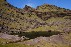 Lake on mountain ireland. Climbing mount brandon in ireland lake Stock Photos