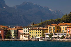 Lake and mountain in Italy. Torbole city in Italy (Garda Lake) in fornt of high mountains Stock Photo
