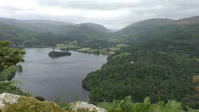 Lake and mountain landscape from top. View over the Grasmere lake in Cumbria, England from top of mountain stock video footage