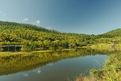 Lake mountain landscape with tourist. At pudazuo national park, Shangri La, China Royalty Free Stock Image
