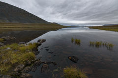 Lake and mountain landscape tranquil scene with overcast, Sweden. Camping along the side of this lake was one of the most beautiful spots of Sarek royalty free stock images
