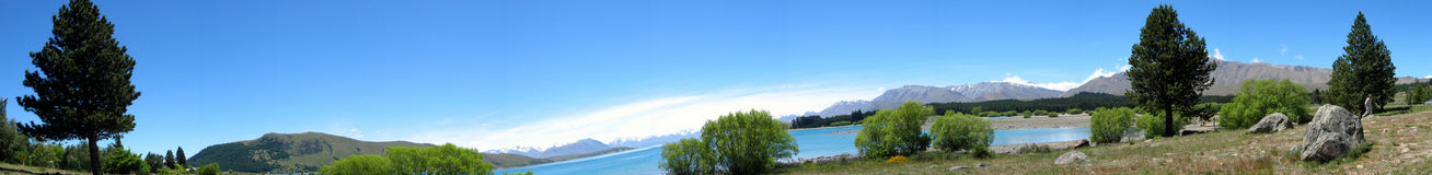 Lake & mountain panorama. A panoramic view overlooking a scenic country lake with Mt. Cook in the background Royalty Free Stock Photo