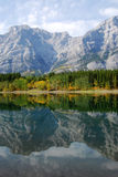 Lake and mountain reflections. Autumn view of lake and mountain reflections in wedge pond, kananaskis country, alberta, canada Royalty Free Stock Images