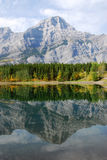 Lake and mountain reflections. Autumn view of lake and mountain reflections in wedge pond, kananaskis country, alberta, canada Royalty Free Stock Photography