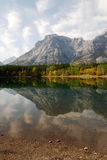Lake and mountain reflections. Autumn view of lake and mountain reflections in wedge pond, kananaskis country, alberta, canada Stock Images