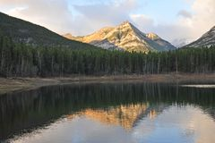 Lake and mountain reflections. In wedge pond in the morning moment, kananaskis country, alberta, canada Stock Images