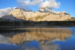 Lake and mountain reflections. In wedge pond in the morning moment, kananaskis country, alberta, canada Royalty Free Stock Photo