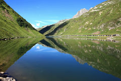 Lake with mountain reflections. Lake in front of a wonderful mountain scenery Stock Images