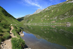Lake with mountain reflections. Lake in front of a wonderful mountain scenery Stock Photo