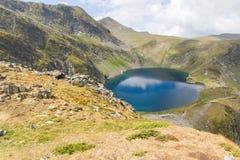 Lake in mountain Rila, Bulgaria. Landscape of blue lake in the Rila mountain in Bulgaria Royalty Free Stock Photography