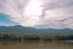 Lake and mountain scenery with beautiful sky. From the shining clouds, landscape royalty free stock photography