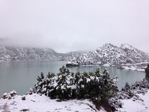 Lake and mountain in snow Stock Images