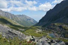 Lake in mountain valley Barguzinsky ridge at Lake Baikal. Royalty Free Stock Photo