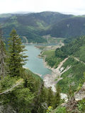 Lake between the mountains. In Romania royalty free stock photos