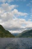 Lake between mountains. Deep lake between mountains, summer royalty free stock photo
