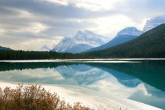 Lake & Mountains. Reflective lake and mountains in Rocky Mountains Royalty Free Stock Images