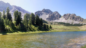 Lake in the mountains. Lac Mirroir in the Queyeras in France Stock Photo