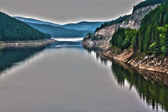 A lake in the mountains. A view of the Carpathian mountains, from the Transalpina road Royalty Free Stock Photography