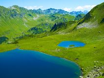 Lake in the mountains. Landscape with a large lake in the Caucasus Mountains Stock Image