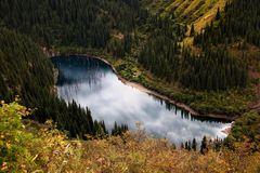 Lake in mountains Stock Images