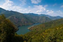 Lake in the mountains. Panorama of Tsankov Kamak Dam in the Rhodope Mountains Stock Photo