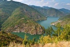 Lake in the mountains. Panorama of Tsankov Kamak Dam in the Rhodope Mountains Royalty Free Stock Photos