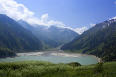 Lake in the mountains. Large almaty lake in the mountains Stock Photography