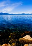 Lake in the mountains. Lake Tahoe with clouds over it Stock Photos