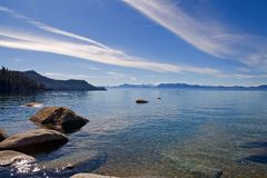 Lake in the mountains. Lake Tahoe with clouds over it Royalty Free Stock Images