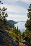 Lake in the mountains. Foggy Lake Tahoe with clouds over it Royalty Free Stock Photo