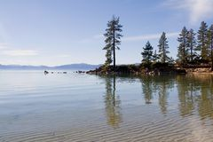 Lake in the mountains. Lake Tahoe with clouds over it Royalty Free Stock Image