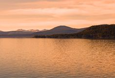 Lake in the mountains. At sunset Royalty Free Stock Photos