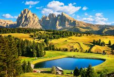 Lake and mountains, Alpe di Siusi or Seiser Alm, Dolomites Alps, royalty free stock images