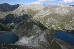 Lake in mountains. Alpine Royalty Free Stock Images