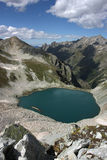 Lake in mountains. Alpine Royalty Free Stock Photo