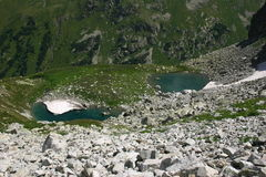 Lake in mountains. Alpine Stock Photo