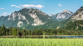 Lake Mountains Alps German Castle Valley Timelapse 4k. Timelapse footage of a beautiful lake in the Bavarian alps in Germany. This is in 4k quality stock video