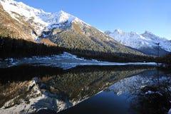 Lake with mountains in autumn Stock Photos