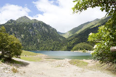 Lake between mountains in the Ayous Lakes Stock Images