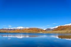 Lake mountains azure sky reflection autumn Royalty Free Stock Image