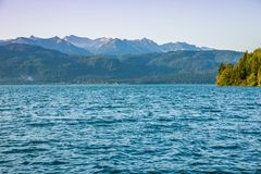 Lake with mountains in the background Royalty Free Stock Photo