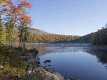 Lake and mountains at beginning of fall Stock Photography