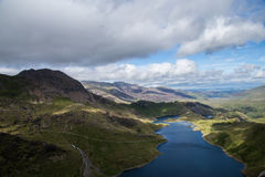 Lake in the mountains. Blue lake seen from the top of the mountain Stock Photos